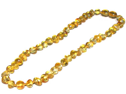 Zeltainas pulētas apaļiem gabaliem
